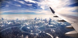 Airplane in flight with view of city